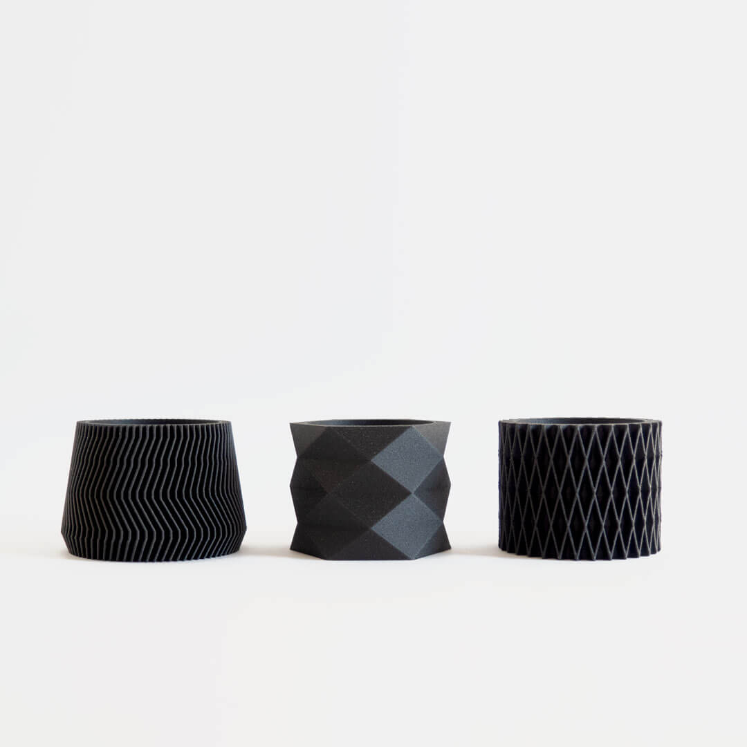 Set of 3 black mini 3D printed planters with geometric and diamond designs.