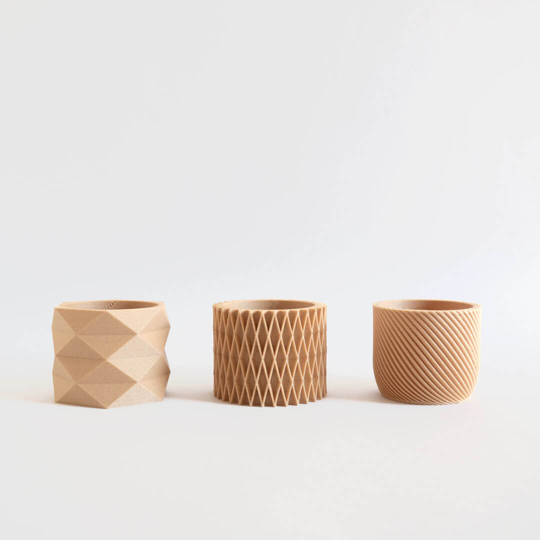 Three mini geometric 3d printed planters on a white background.