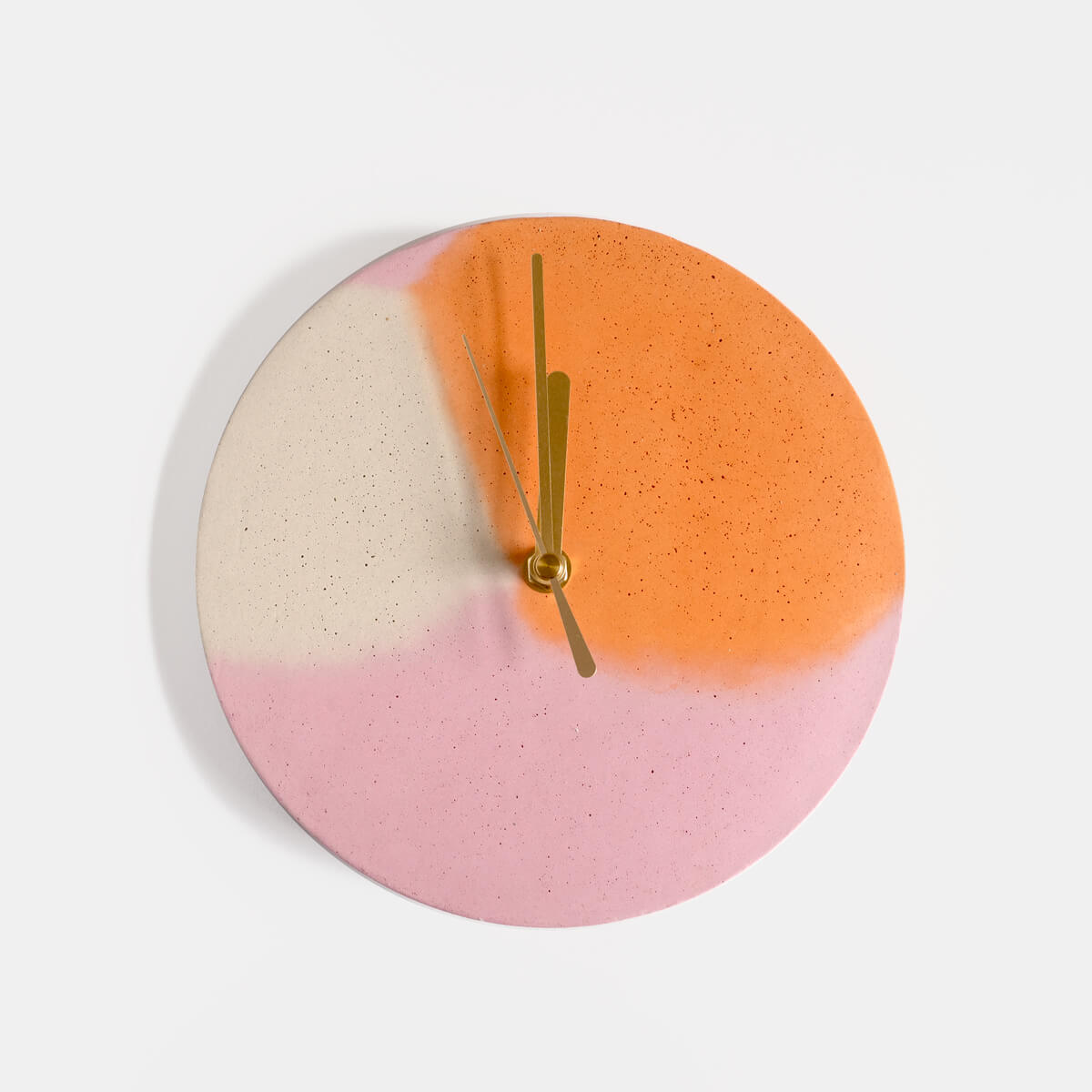 Pink and orange round concrete wall clock by Studio Emma for Curious Makers