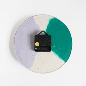 The back of a round concrete wall clock by Studio Emma for Curious Makers