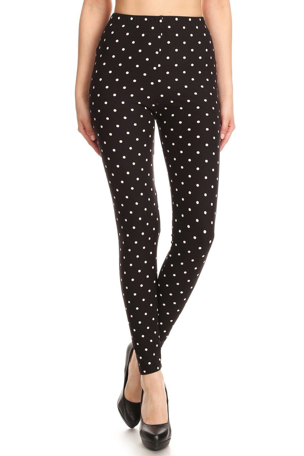 High Waisted Leggings With An Elastic Band In A White Polka Dot Print Over A Black Background - De Bawa Inc.