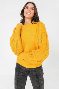A Sweater Featuring Round Neckline, Puff Sleeves With Wide Cuffs