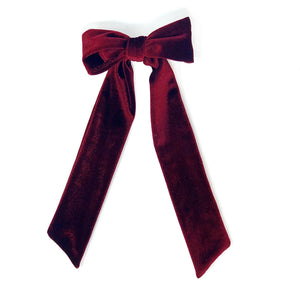 Hair clip with a long velvet bow in dark red color