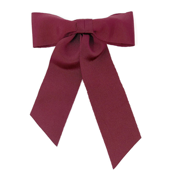 Hair clip with a big bow in red color