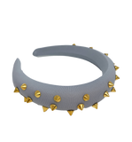 Grey padded headband with gold spikes