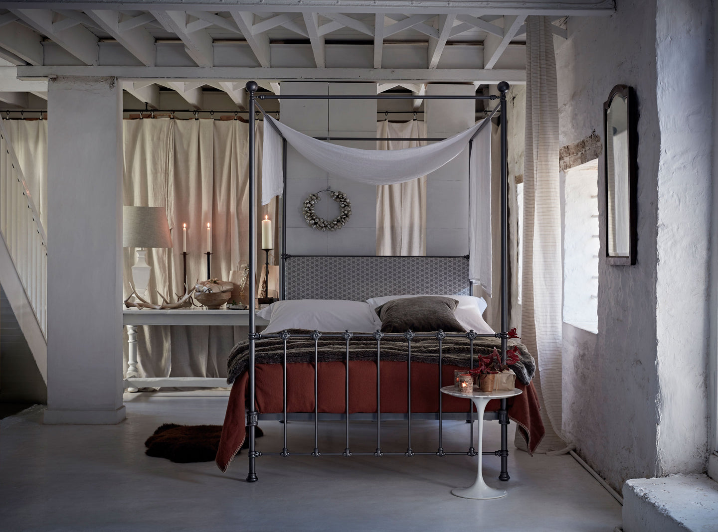 Five ways to dress a metal four-poster bed