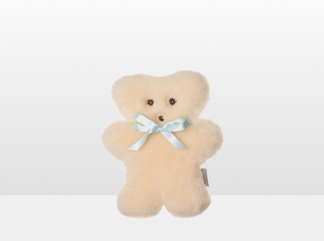 Kids Cream Sheepskin Flat Bear with Blue Ribbon