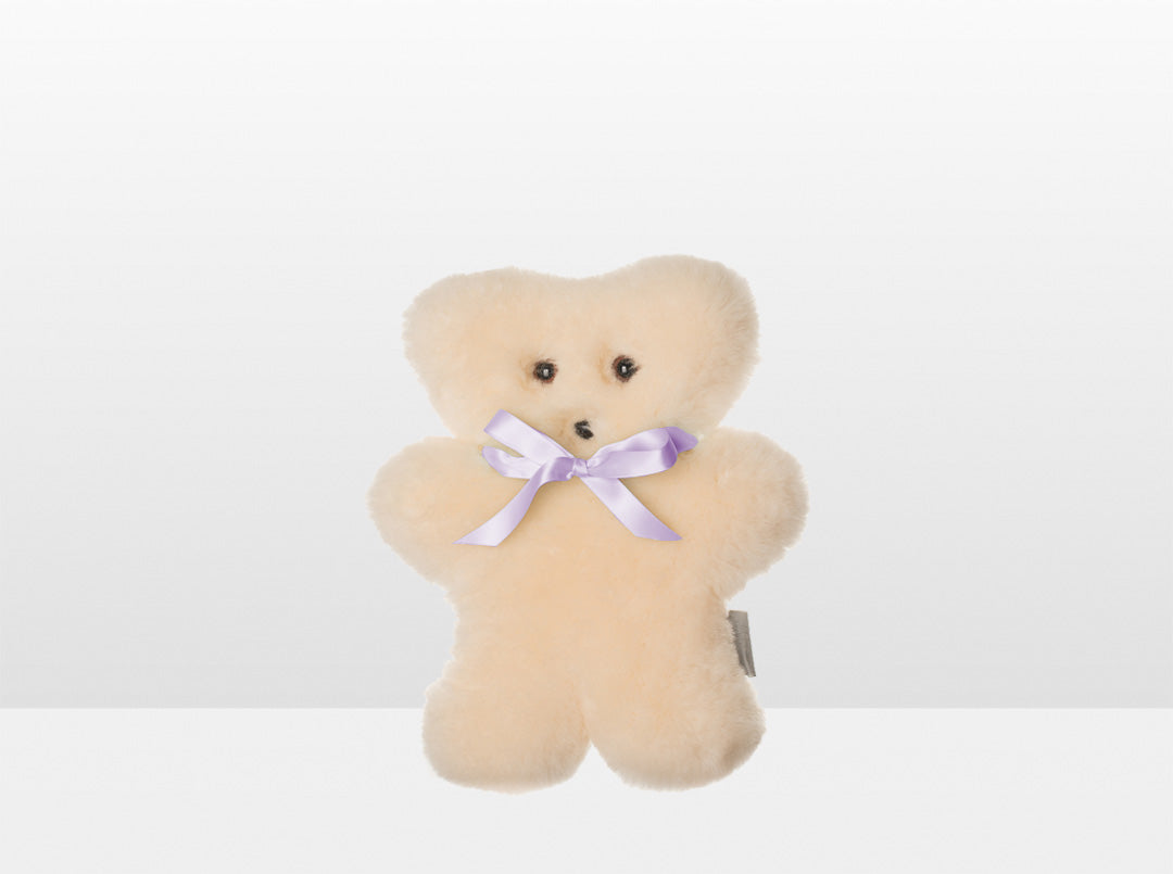 Kids Cream Sheepskin Flat Bear with Purple Ribbon