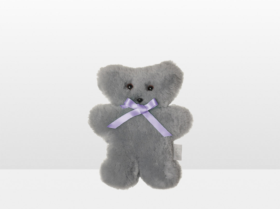 Kids Silver Fox Sheepskin Flat Bear with Purple Ribbon