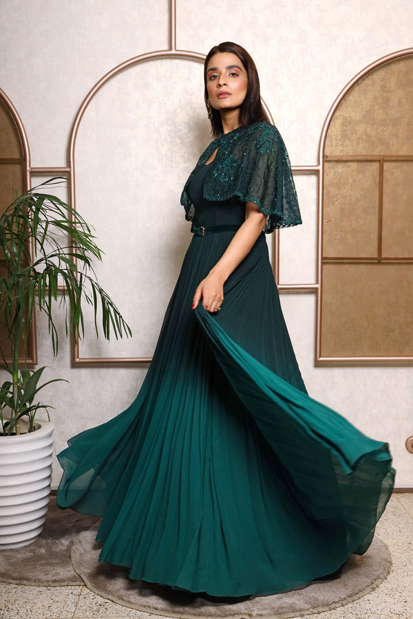 Gown With An Embroidered Overlay And Velvet Belt