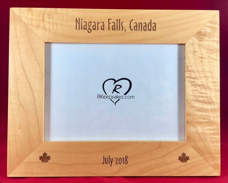 Canada Picture frame with custom text and maple leaf images engraved, in alder