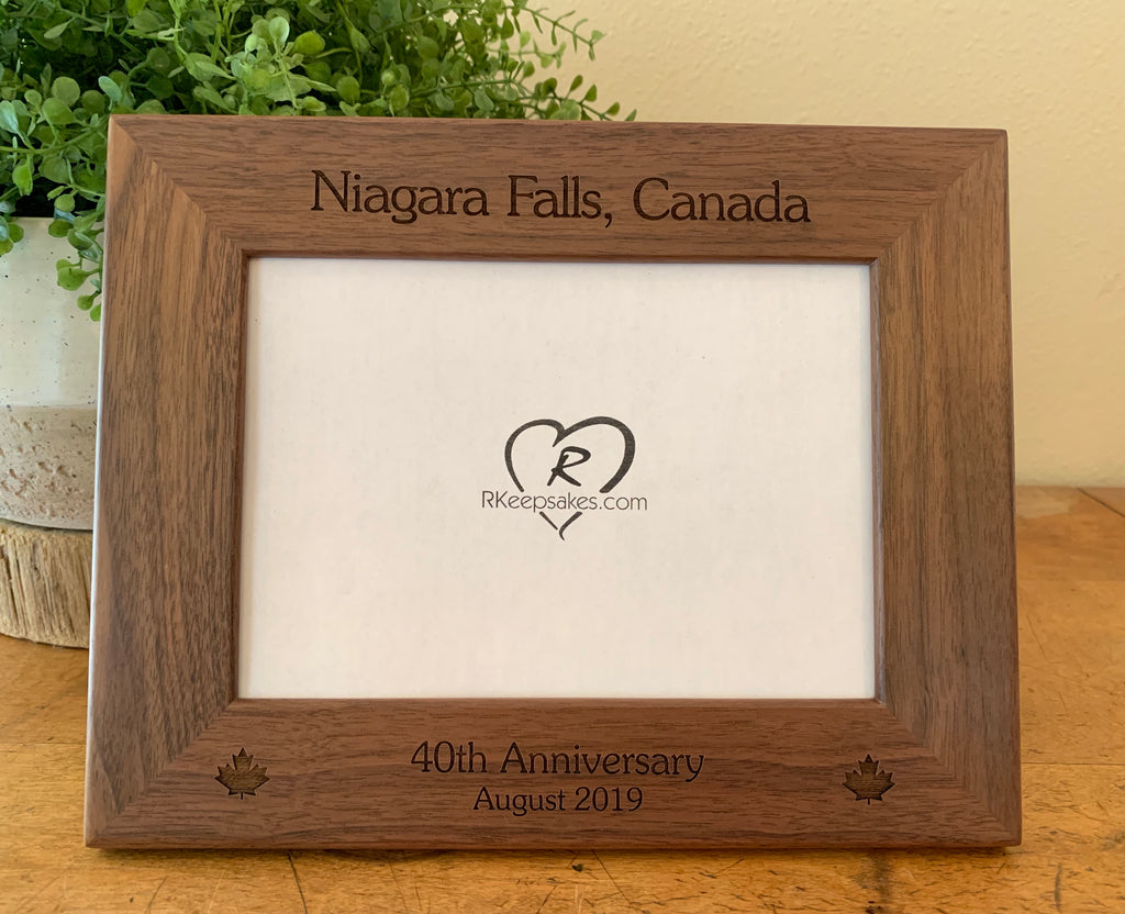 Canada Picture frame with custom text and maple leaf images engraved, in walnut