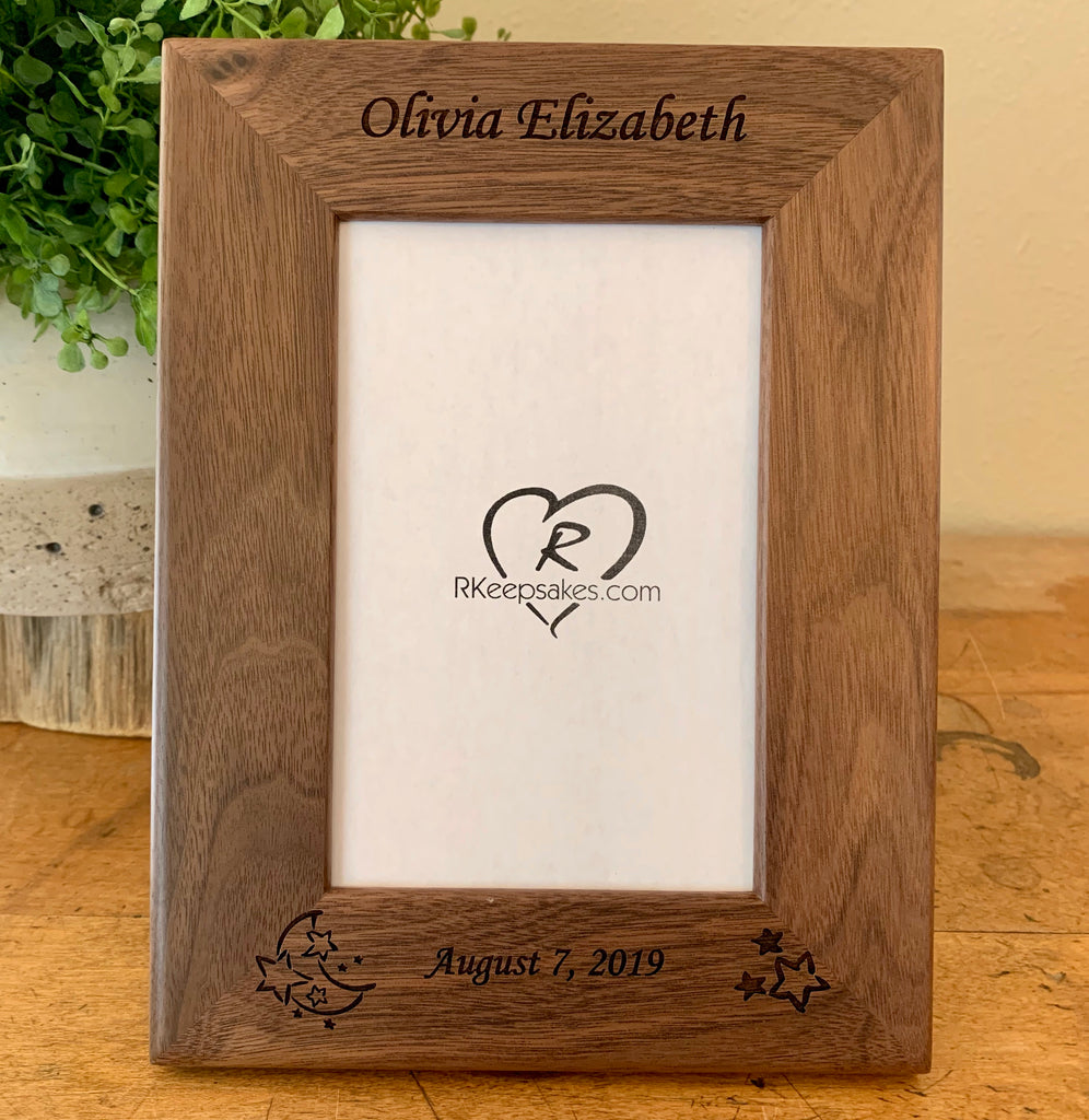 Personalized baby frame in walnut, with custom text and moon, stars engraved at bottom