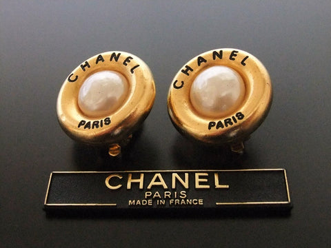 Authentic vintage Chanel earrings gold logo pearl round