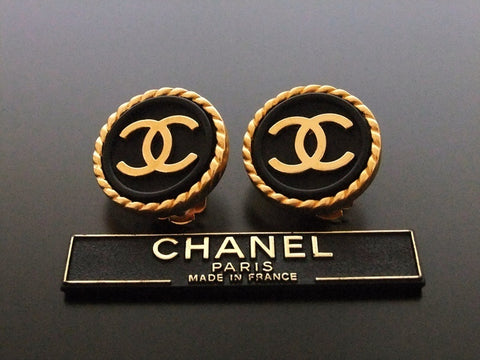 Authentic vintage Chanel earrings gold CC black button round