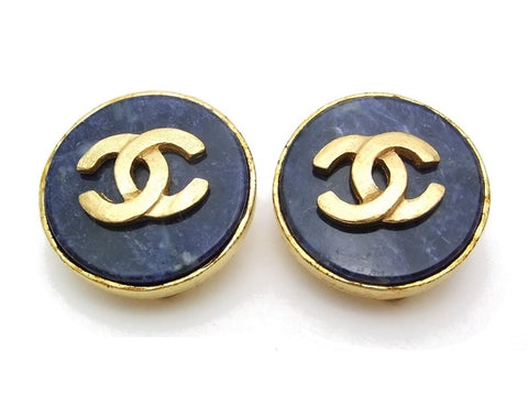 Authentic vintage Chanel earrings gold CC navy blue stone round
