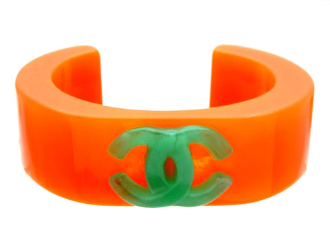 Vintage Chanel cuff bracelet green CC logo orange plastic