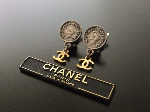 Authentic vintage Chanel earrings COCO medal swing gold CC
