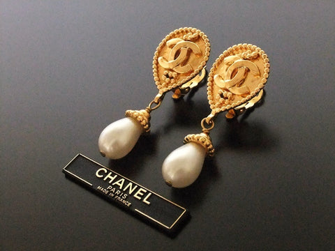 Authentic vintage Chanel earrings gold CC swing pearl drop