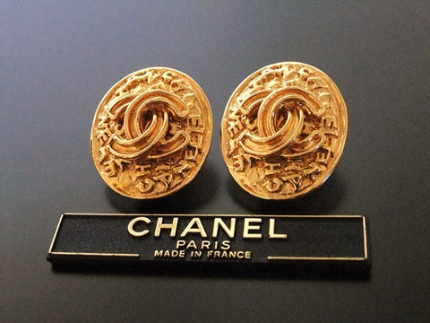 Authentic vintage Chanel earrings gold CC logo round