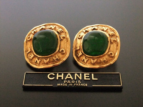 Authentic vintage Chanel earrings gold logo green glass stone