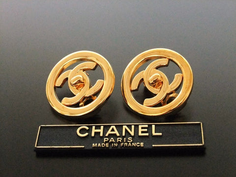 Authentic vintage Chanel earrings gold turnlock CC round