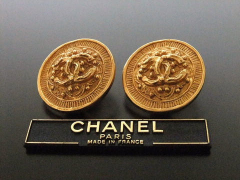 Authentic vintage Chanel earrings gold CC round