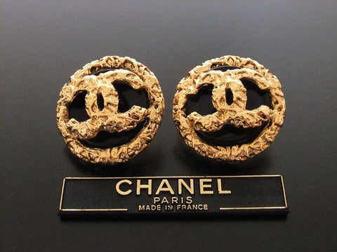 Authentic vintage Chanel earrings gold CC black plastic round