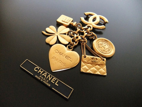Authentic Vintage Chanel pin brooch gold CC swing icon charm