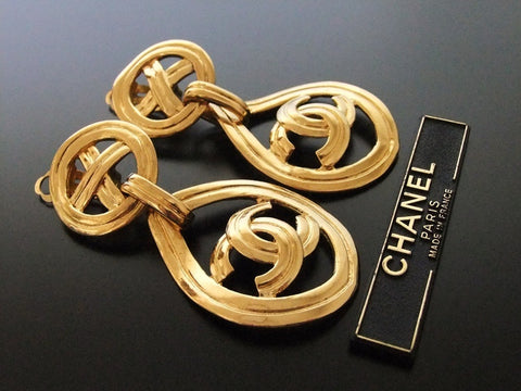 Authentic vintage Chanel earrings swing gold CC hoop dangle