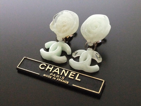 Authentic vintage Chanel earrings camellia swing CC white green