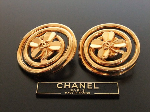 Authentic vintage Chanel earrings gold CC clover round