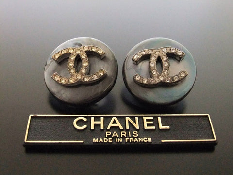 Authentic vintage Chanel earrings rhinestone CC aurora round