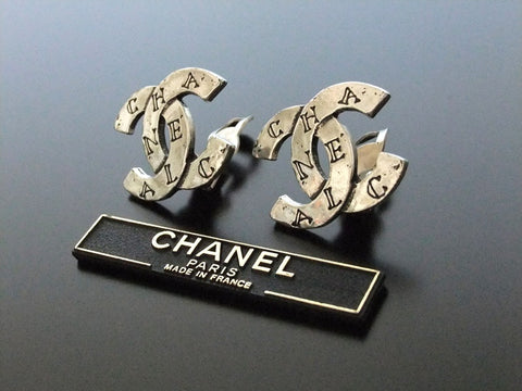 Authentic vintage Chanel earrings silver logo CC
