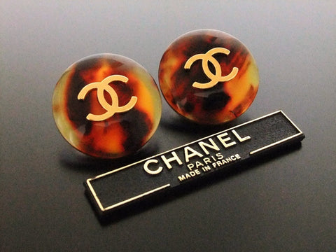 Authentic vintage Chanel earrings gold CC brown round