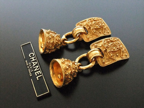 Authentic vintage Chanel earrings gold CC swing bell