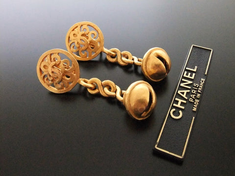 Authentic vintage Chanel earrings gold CC swing bell dangle