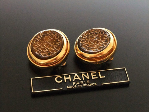 Authentic vintage Chanel earrings logo brown glass stone round