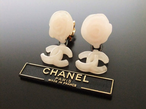 Authentic vintage Chanel earrings white pink camellia swing CC dangle