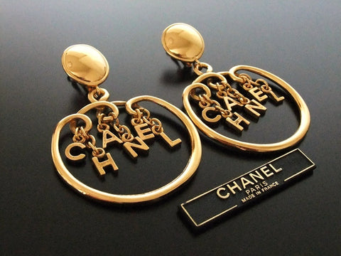 Authentic vintage Chanel earrings gold swing logo huge