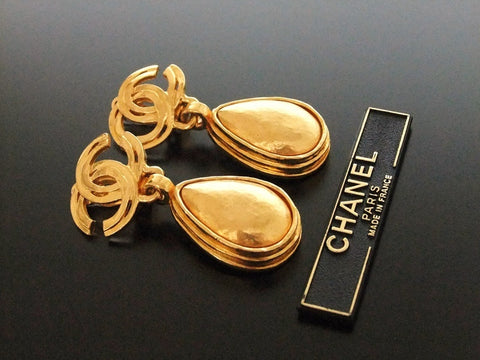 Authentic vintage Chanel earrings gold CC swing drop