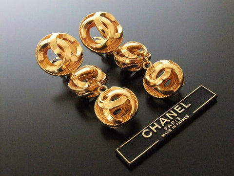 Authentic Vintage Chanel earrings swing gold triple CC ball