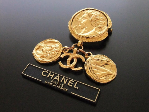 Authentic vintage Chanel pin brooch gold swing CC horse medal dangle