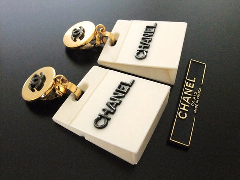 Authentic vintage Chanel earrings black CC logo swing white bag rare