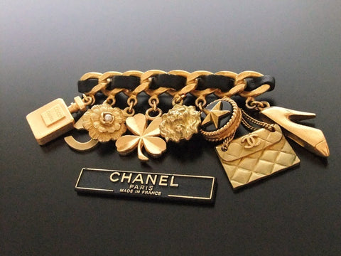 Authentic vintage Chanel pin brooch gold CC 8 icon charms rare