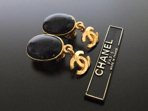 Authentic vintage Chanel earrings navy blue stone gold swing CC
