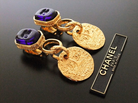 Authentic vintage Chanel earrings navy blue glass swing CC medal