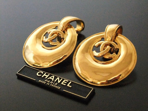 Authentic vintage Chanel earrings gold swing disc CC dangle large