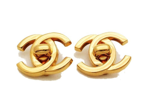 Authentic vintage Chanel earrings gold turnlock CC small