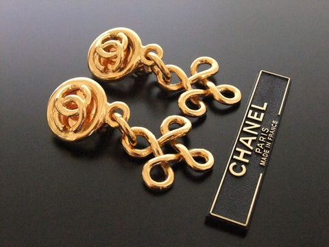 Authentic vintage Chanel earrings gold CC swing dangle large